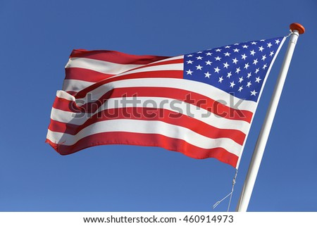 flag of the United Stated blowing in the wind