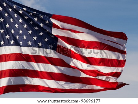 Flag of the United States of America flies in a strong breeze.