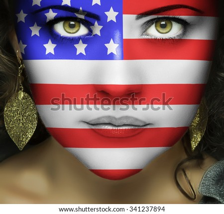 Flag of the United States of America on the woman's face with green eyes - stock photo