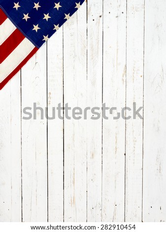 Flag of the United States of America on white wooden background - stock photo