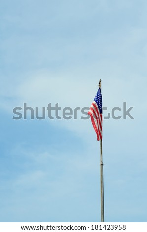Flag of the United States of America(USA) on blue sky - stock photo