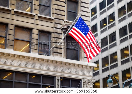 Flag of the United States on a skyscrapper in New York City - stock photo