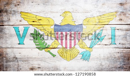 Flag of the United States Virgin Islands painted on grungy wood plank background - stock photo
