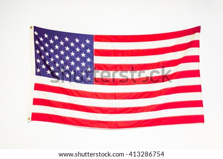Flag of the USA (United States of America) on white wall - stock photo
