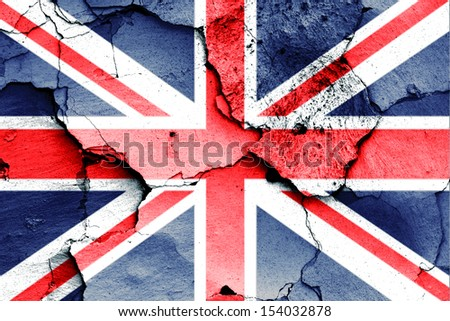 flag of UK painted on cracked wall - stock photo