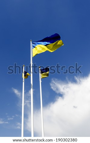 Flag of Ukraine against the background of blue sky - stock photo