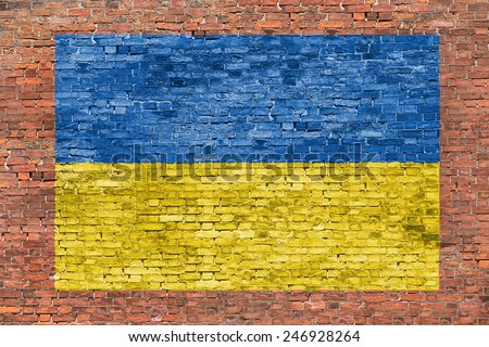 Flag of Ukraine painted over aged brick wall