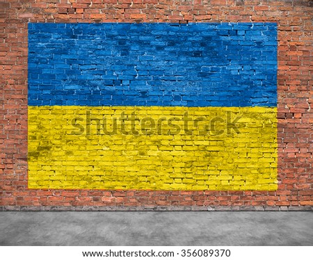 Flag of Ukraine painted over aged brick wall - stock photo