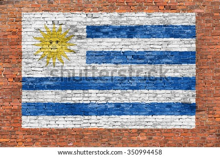Flag of Uruguay painted on old brick wall - stock photo