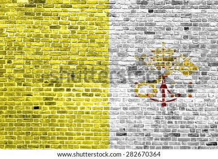 Flag of Vatican City painted on brick wall, background texture - stock photo