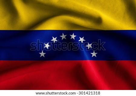 Flag of Venezuela. Flag has a detailed realistic fabric texture. - stock photo
