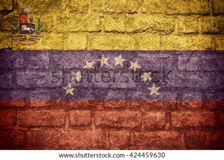 flag of Venezuela or Venezuelan banner on brick texture