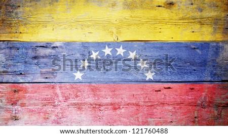 Flag of Venezuela painted on grungy wood plank background - stock photo