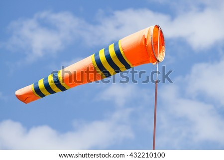 Flag of windsock in airport on the blue sky