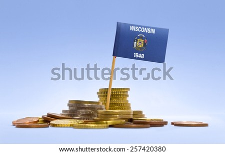 Flag of Wisconsin in a stack of coins.(series) - stock photo