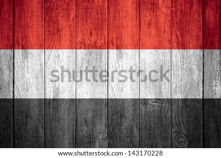 flag of Yemen or red, white and black Yemeni  banner on wooden background