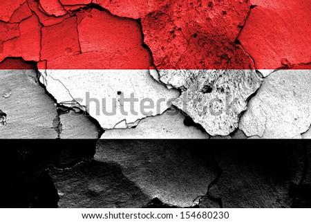 flag of Yemen painted on cracked wall - stock photo