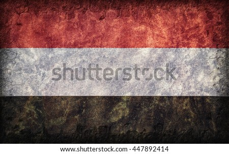Flag of Yemen painted onto a rough wall