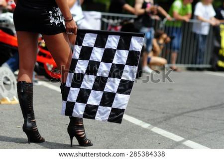 flag on start - girl with beautiful legs  - stock photo
