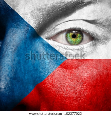 Flag painted on face with green eye to show Czech support
