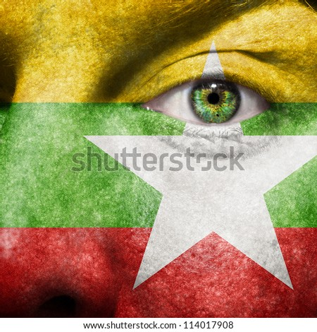 Flag painted on face with green eye to show Myanmar support