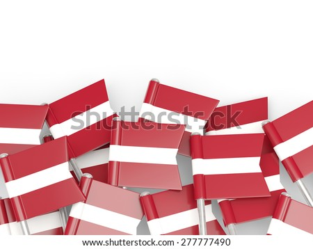 Flag pin of latvia isolated on white
