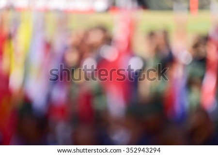 Flag ranks in the green grass. Tropical landscape blur ,  Military flag blur the line  - stock photo