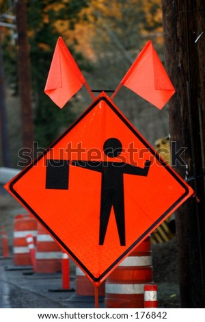 Flagger Ahead - stock photo