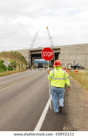 Flagger controlling the traffic during The rebuilding of the Shady Bridge of Interstate 5 crossing the South Umpqua River just south of Roseburg Oregon - stock photo