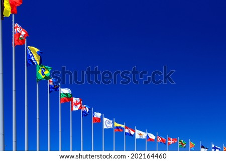 Flags against blue sky, copyspace. - stock photo