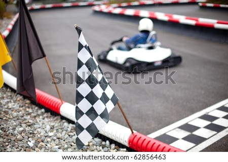 flags and cars on carting track - stock photo