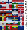 Flags and maps of European Union countries on a sackcloth - stock photo