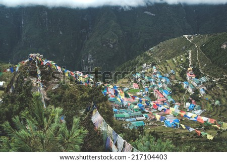 flags and the town of Namche Bazaar in Nepal