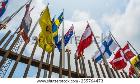 Flags  blowing and clouds on blue sky background.  Flags  blowing  and clouds.