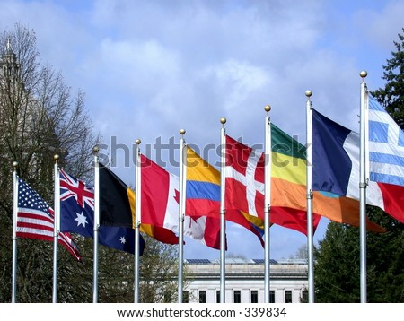 Flags from many different nations fly side by side - stock photo