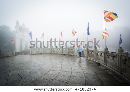 Flags in fog at Ngong Ping, on Lantau Island, Hong Kong.