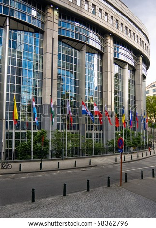 Flags in front of European Parliament towers - Brussels, Belgium - stock photo