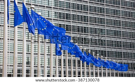 Flags in front of the EU Commission building in Brussels  - stock photo