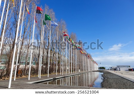 Flags of all the countries of the world waving in the wind at the Rossio dos Olivais (Olive Grove Square). Parque das Nacoes (Park of Nations), Lisbon, Portugal - stock photo