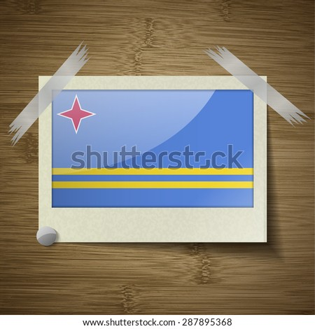 Flags of Aruba at frame on wooden texture.  illustration. Rastrized version - stock photo