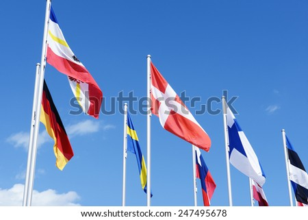 flags of Baltic sea states like Sweden, Germany, Finland and so on waving in the winds.