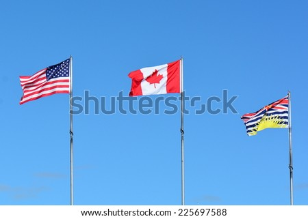Flags of Canada and the United States. - stock photo