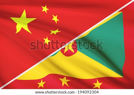 Flags of China and Grenada blowing in the wind. Part of a series. - stock photo