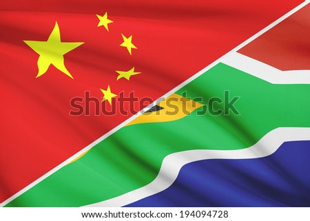 Flags of China and Republic of South Africa blowing in the wind. Part of a series. - stock photo