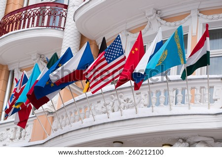 Flags of different countries above the door of a hotel, Marianske Lazne aka Marienbad -Czech republic - stock photo