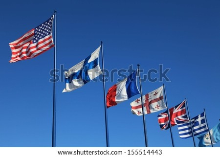 Flags of different countries waving outdoors