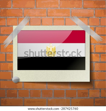 Flags of Egypt scotch taped to a red brick wall.  Rasterized version - stock photo