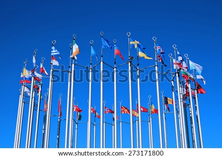 Flags of European countries against the blue sky - stock photo