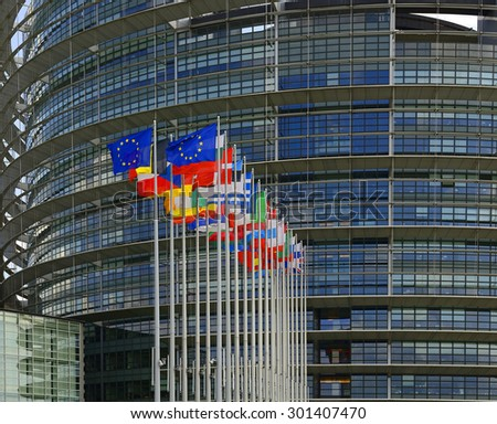 Flags of European Union countries before the European Parliament building in Strasbourg - stock photo