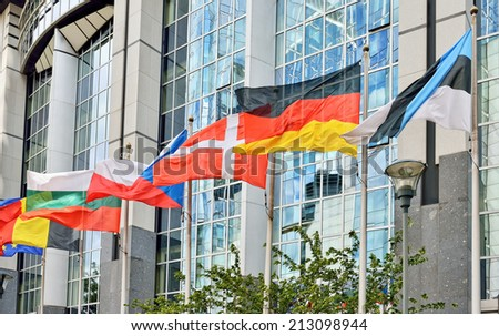 Flags of European Union countries waving near modern European Parliament building in Brussels, Belgium - stock photo